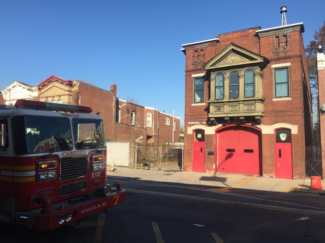 A firetruck is parked outside Camden's Engine 7 Firehouse on Kaighns Avenue. The city closed the firehouse because of concerns about the structure's safety.