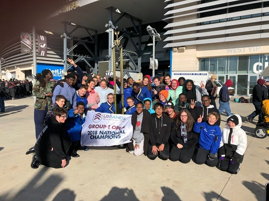 Members of the Burlington City High School marching band are shown after winning their USBands Group I Open Class National Championship at MetLife Stadium in East Rutherford recently. It was their second straight national title.
