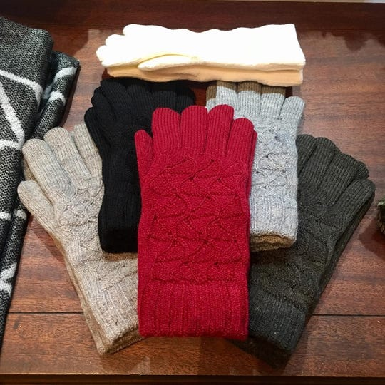 Curvy Gal Consignment carries secondhand items as well as new merchandise, like these gloves in a variety of colors.