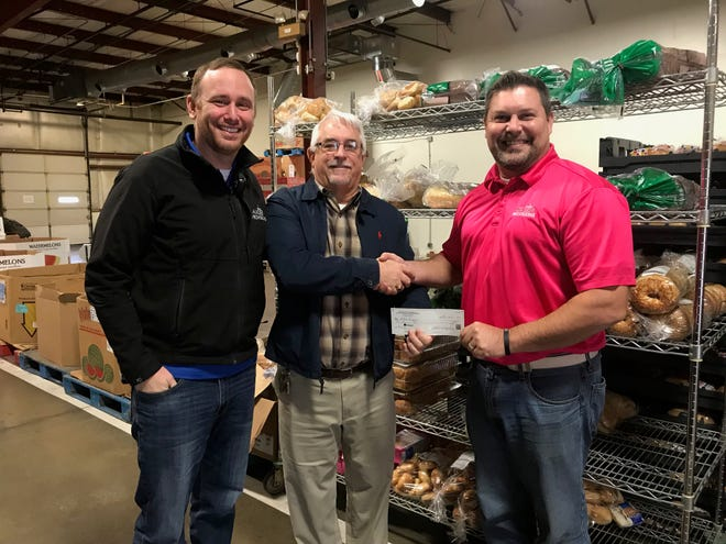 From left: Guy Domec, Master Provisions operations director; Bill Winegardner of ACE Hardware; and Jeff Schaaf, Master Provisions operations manager.