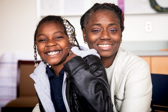 Martaisha Thomas, 7, poses for a portrait with her great aunt Stephanie Hummons after school Tuesday, November 20, 2018 at Carson Elementary in Price Hill. Hummons is raising Martaisha and her little brother.