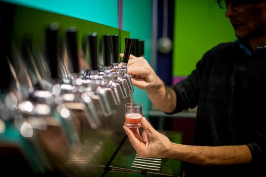 Jordan Aversman pours a sample of kombucha in the Fab Ferments tap room in Lockland Monday, November 19, 2018.