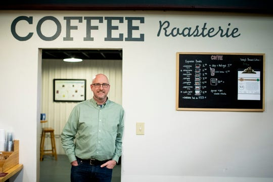 David Gaines, ceo of La Terza Coffee, poses for a portrait inside the La Terza Artisan Coffee Roasterie in Lockland Monday, November 19, 2018. They specialize in distributing freshly and expertly roasted coffee beans to coffee houses and restaurants.