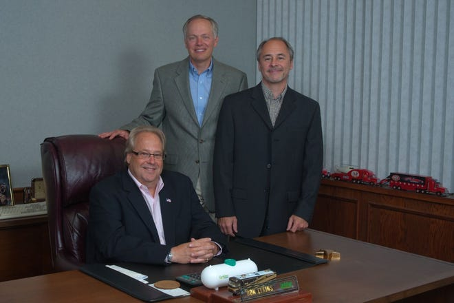 Lykins Energy Solutions executives include President Jeff Lykins, seated, with  Vice Presidents Robert Manning, center,  and Ronald Lykins.