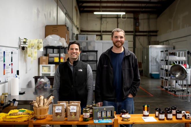 Eduardo Rodriguez, cheesemaker and owner of My Artisano Foods, poses next to Adam Cady, assistant cheesemaker, inside their retail space in Lockland Monday, November 19, 2018. Rodriguez founded My Artisano in June 2012.