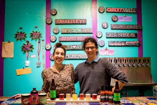 Jennifer De Marco and Jordan Aversman pose for a portrait in their Fab Ferments tap room in Lockland Monday, November 19, 2018. De Marco and Aversman started Fab Fermants in 2008. They specialize in kombucha and organic raw cultured foods, like sauerkraut, kimchi, beet kvass, hot sauce.