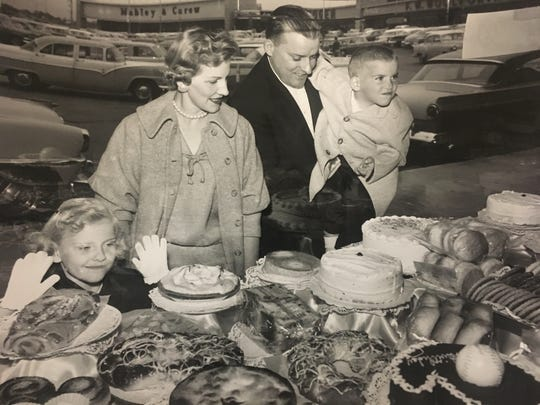 A family inspects baked goods in 1958 at the Western Hills Plaza
