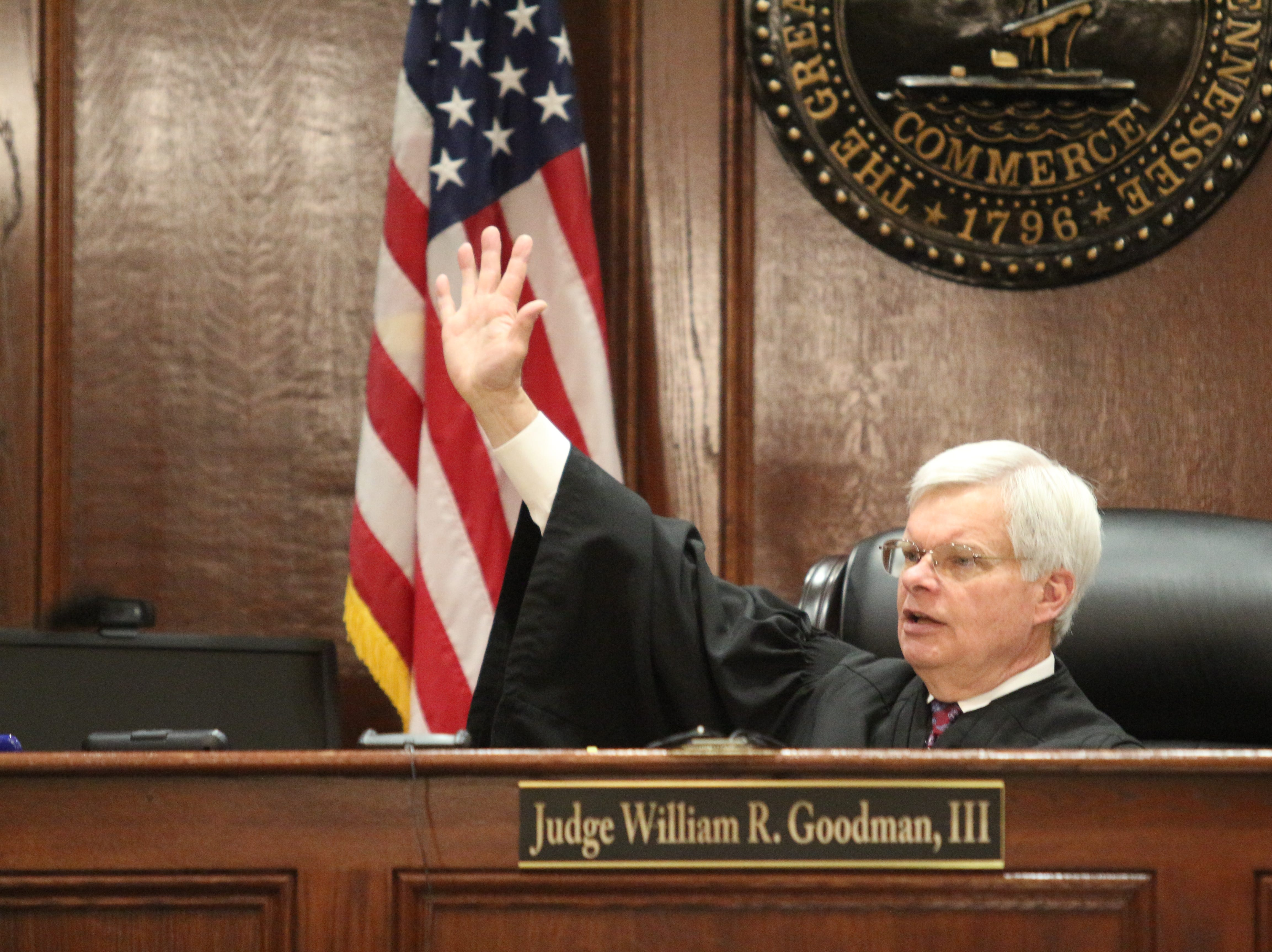 Circuit Court Judge William Goodman III asks the jury to raise their hands to verify they have not talked about or researched the case overnight before trial resumes Wednesday in the case of Samson Peltier who opened fire on another vehicle after a fender bender in 2015.
