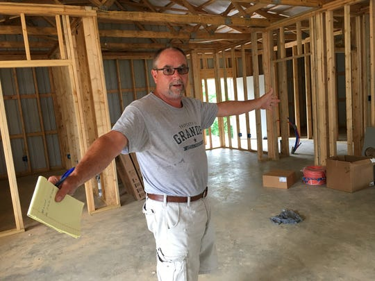 Tommy Crouch explains his ideas for Miss Kay's Country Store during construction.
