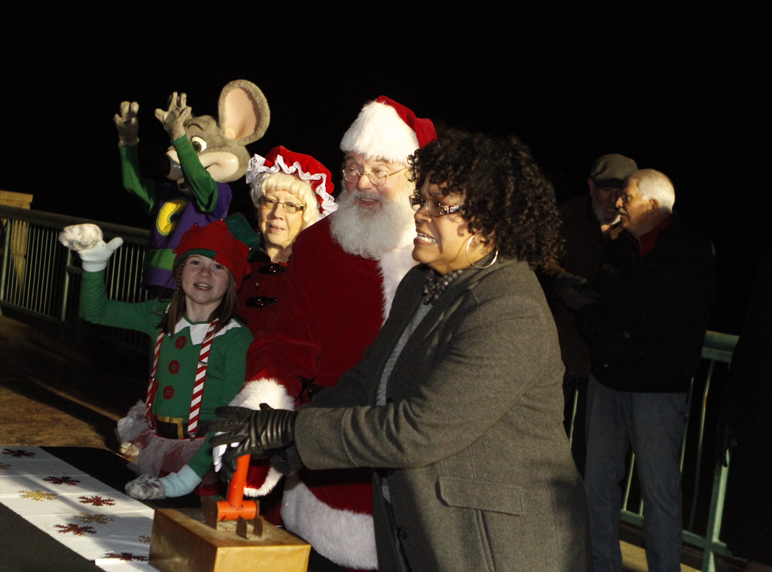 Mayor mayor pro tem Councilwoman Valerie Guzman and Santa Claus flip the switch as the City of Clarksville kicked off its annual Christmas on the Cumberland Tuesday, Nov. 20, 2018, with over 2 million lights in the display.