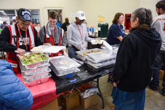 Red Cross volunteers Garry and Amber Hillis of Clarksville work at a shelter in California for fire victims.