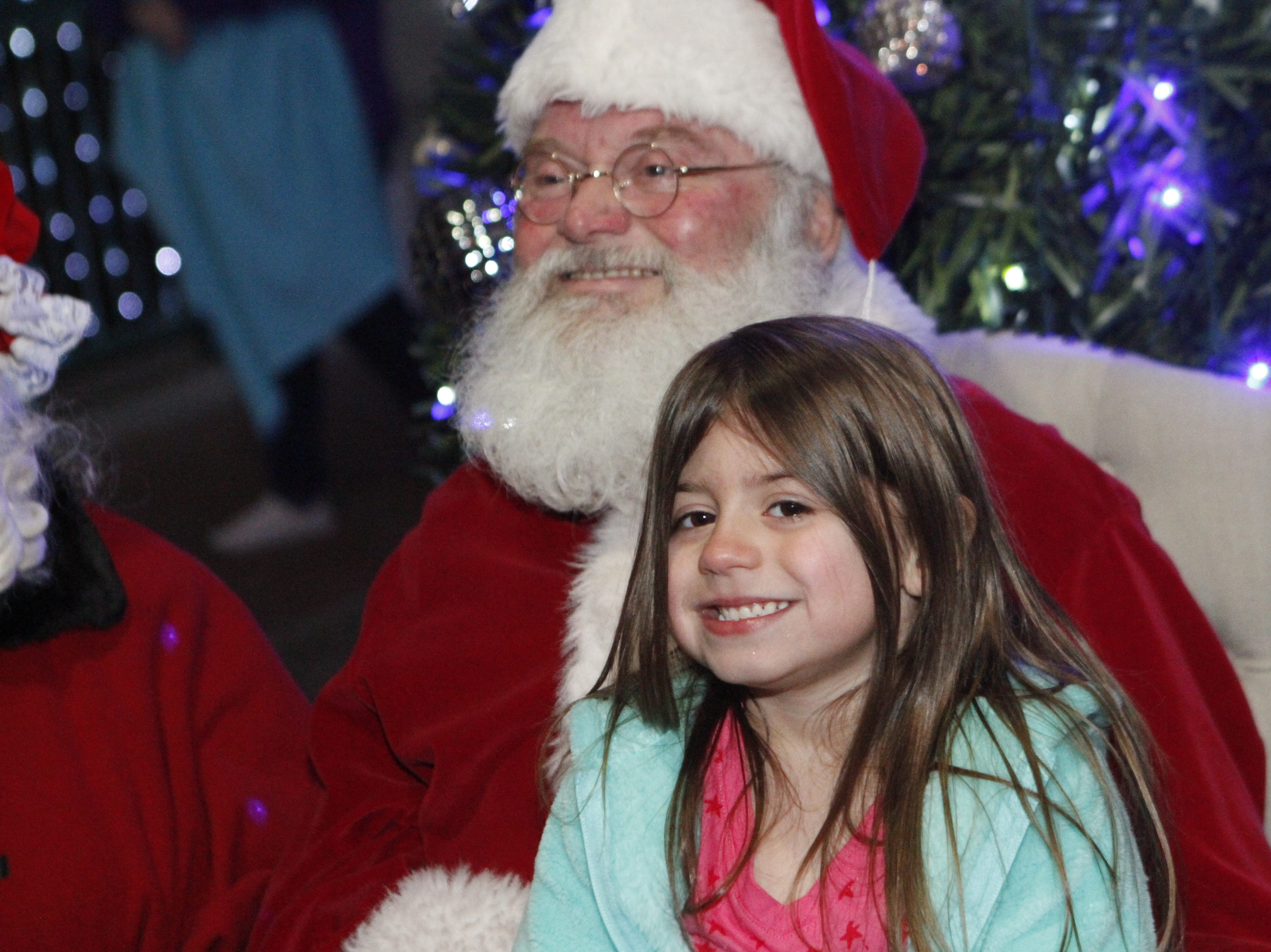 Santa Claus visits with the kids as the City of Clarksville kicked off its annual Christmas on the Cumberland Tuesday, Nov. 20, 2018, with over 2 million lights in the display.
