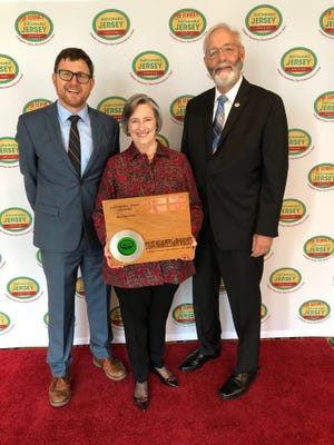 Randall Solomon, executive director of Sustainable Jersey (left) and Richard Dover, chairperson, Board of Trustees, Sustainable Jersey (right) present Mary Reece, chairperson of the Montgomery Environmental Commission/Sustainable Montgomery with Montgomery's Bronze Award level Certification for 2018-20.