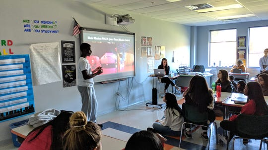Pascal Osei, a 10th grader at Thomas Edison EnergySmart Charter School, gave a presentation to his class about his experience over the summer at Advanced Space Academy at Space Camp USA located in Huntsville, Alabama.