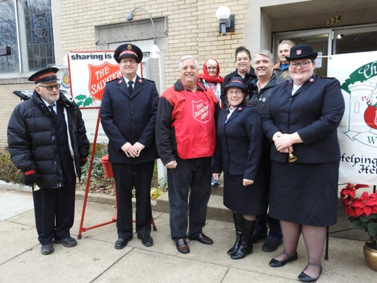 The Salvation Army annual red kettle campaign kicked-off recently with a brief ceremony at the local chapter featuring volunteer Willis Pigman, Capt. Tom Clark, Mayor Steve Mercer, Capt. Vicki Clark, City Safety Service Director Max Crown and Lt. Ariann Maupin. In the back row are donation coordinator Pat Barker, case manager Juanita Griffiths and volunteer Patty Pigman.