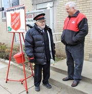 Longtime Salvation Army volunteer Willis Pigman talks with Mayor Steve Mercer prior to the 2018 kick-off ceremony for the annual red kettle campaign in this Tribune file photo.