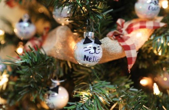 A tiny cat-themed Christmas ball on a tree at the Warsaw Festival of Trees. The tree was decorated by Feral Mountain.