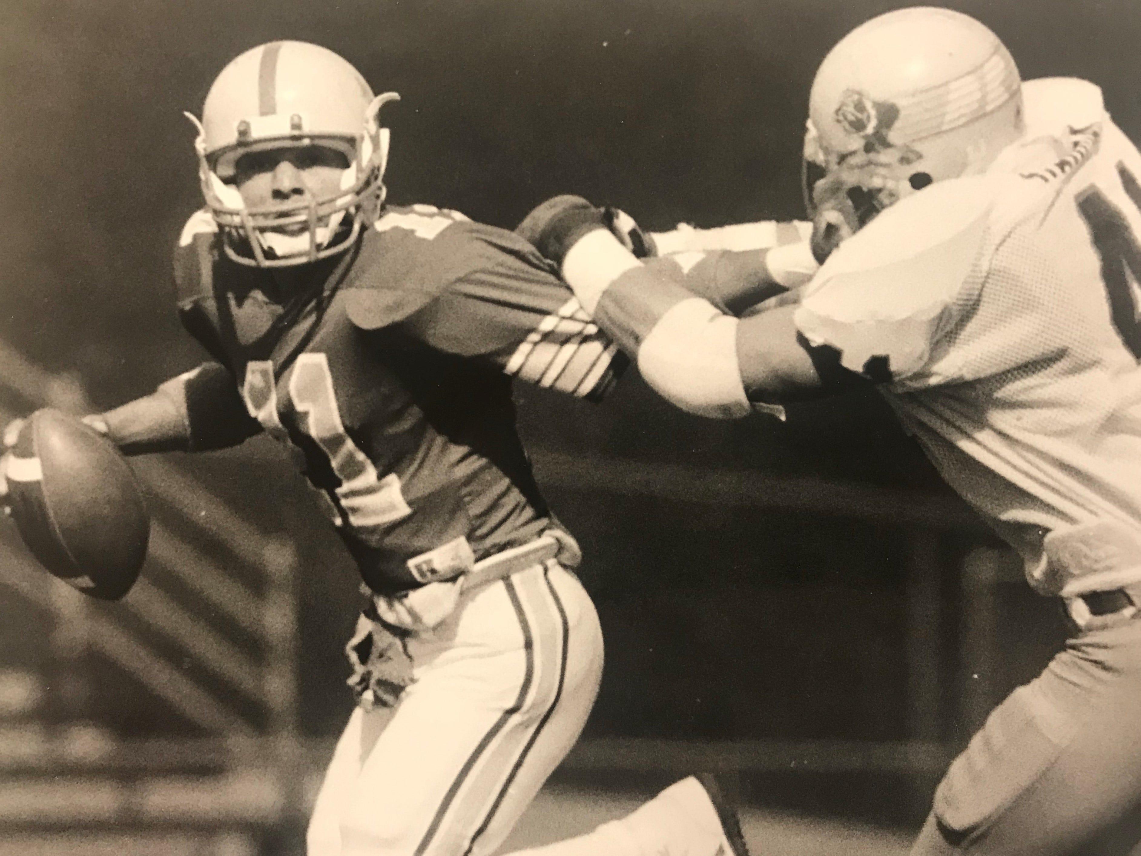From 1985: Iowa State quarterback Alex Espinoza tries to elude Darke's Wade Harman during the Bulldogs' 20-17 win Oct. 5, 1985.