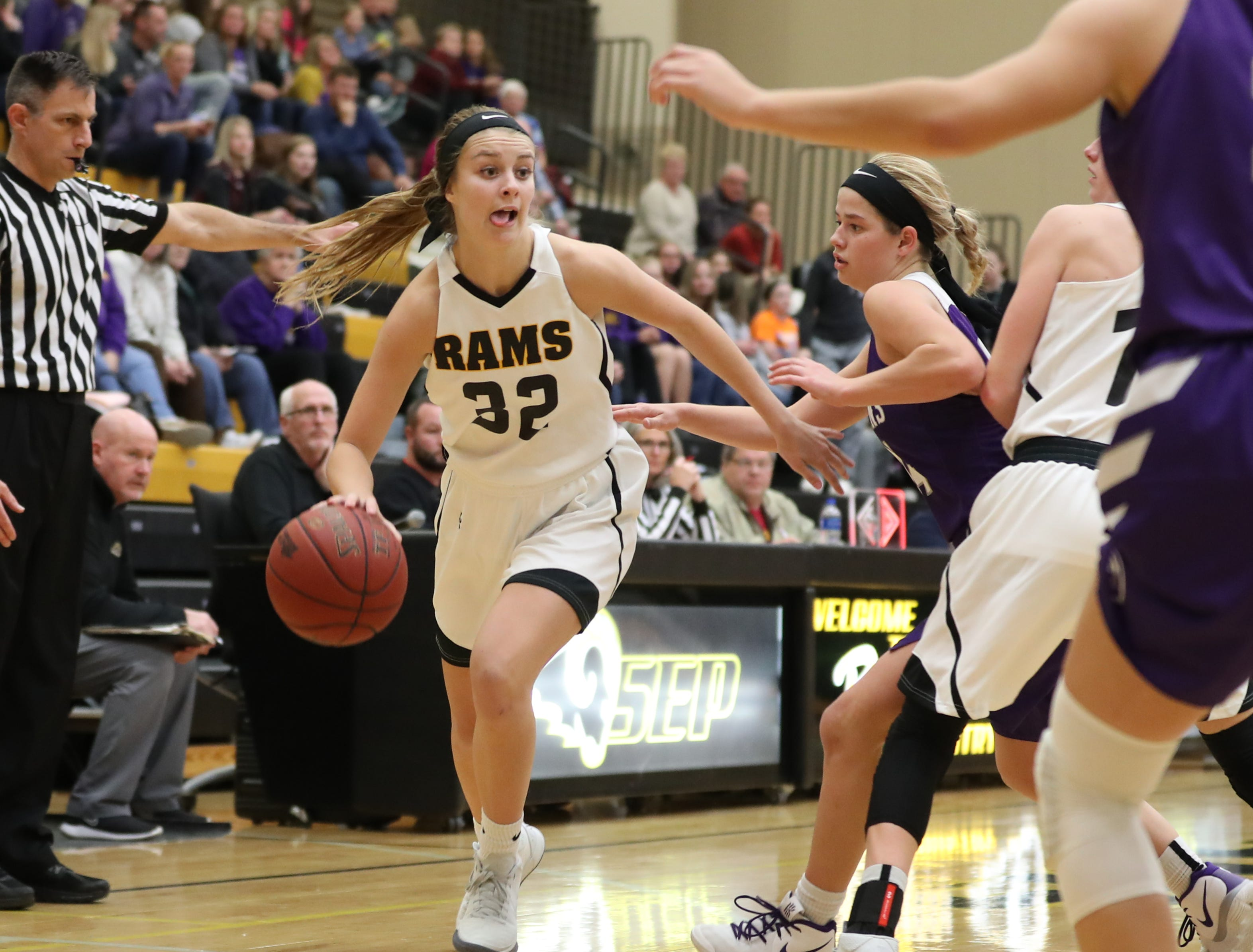 Nov 20, 2018; Pleasant Hill, IA, USA; Southeast Polk Rams Maggie McGraw (32) drives to the basket against the Indianola Indians at Southeast Polk Gymnasium.
