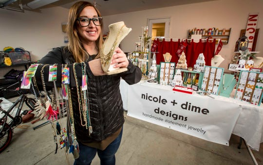 Nicole Rutherford, who is a mom and a crafter, in her garage/studio Tuesday, Nov. 20, 2018, in West Des Moines, Iowa. The hours and home life appealed to Rutherford in the making/crafting industry, which is dominated by women.