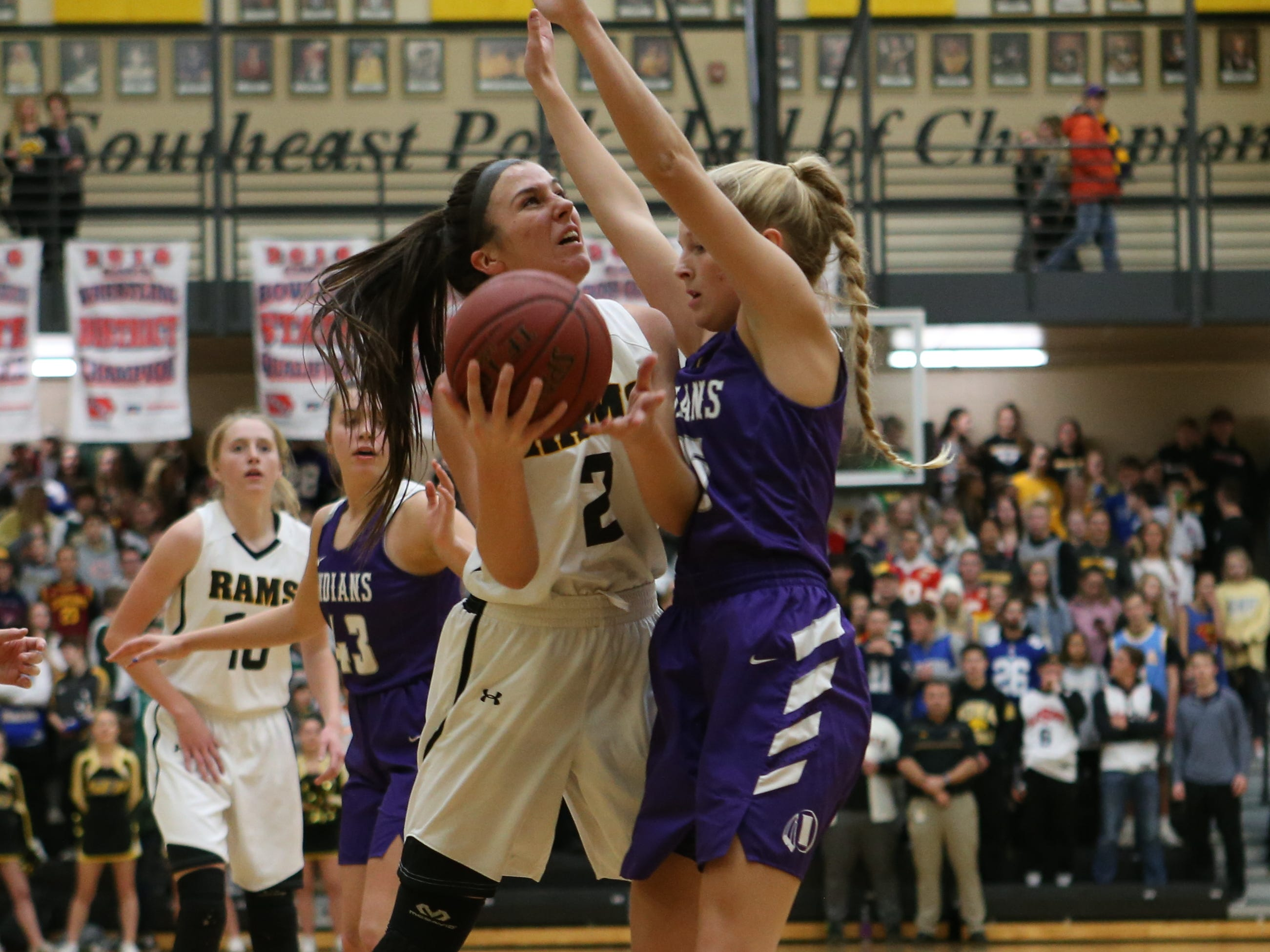 Nov 20, 2018; Pleasant Hill, IA, USA; Indianola's Alley May defends the shot of Southeast Polk Rams Liza Sutten (2) during their game at Southeast Polk Gymnasium.