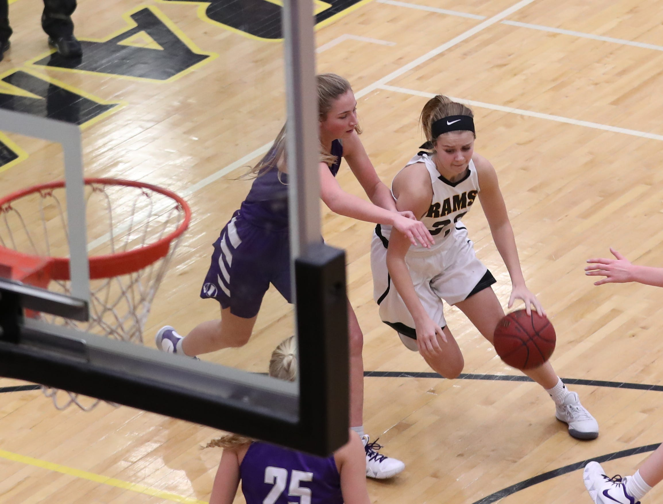 Nov 20, 2018; Pleasant Hill, IA, USA; Southeast Polk Rams Maggie McGraw (32) drives the ball to the basket against the Indianola Indians at Southeast Polk Gymnasium.