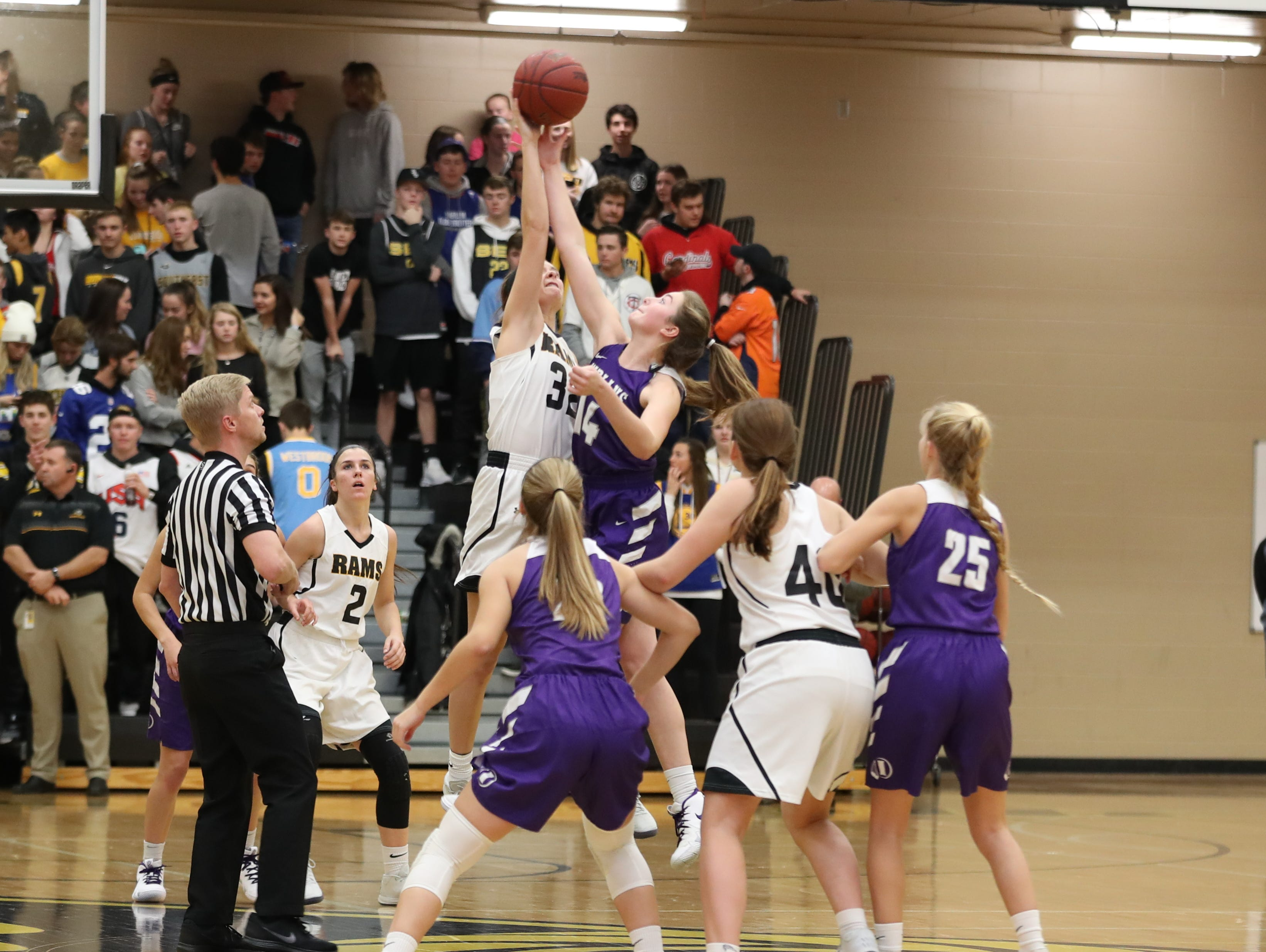 Nov 20, 2018; Pleasant Hill, IA, USA; Southeast Polk Rams Maggie McGraw (32) jumps off with Indianola's Laura Blake during their game with the Indianola Indians at Southeast Polk Gymnasium.