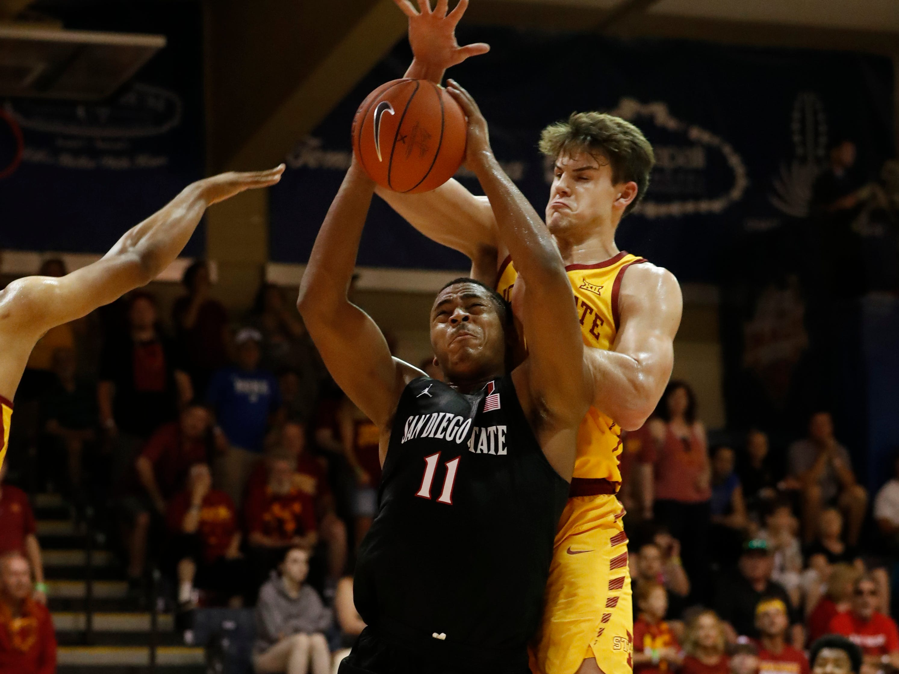 Iowa State forward Michael Jacobson (12) fouls San Diego State forward Matt Mitchell (11) during the first half of a NCAA college basketball game at the Maui Invitational, Wednesday, Nov. 21, 2018, in Lahaina, Hawaii. (AP Photo/Marco Garcia)