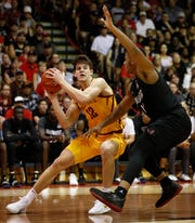 San Diego State forward Matt Mitchell (11) guards Iowa State forward Michael Jacobson (12) during the first half of a NCAA college basketball game at the Maui Invitational, Wednesday, Nov. 21, 2018, in Lahaina, Hawaii. (AP Photo/Marco Garcia)