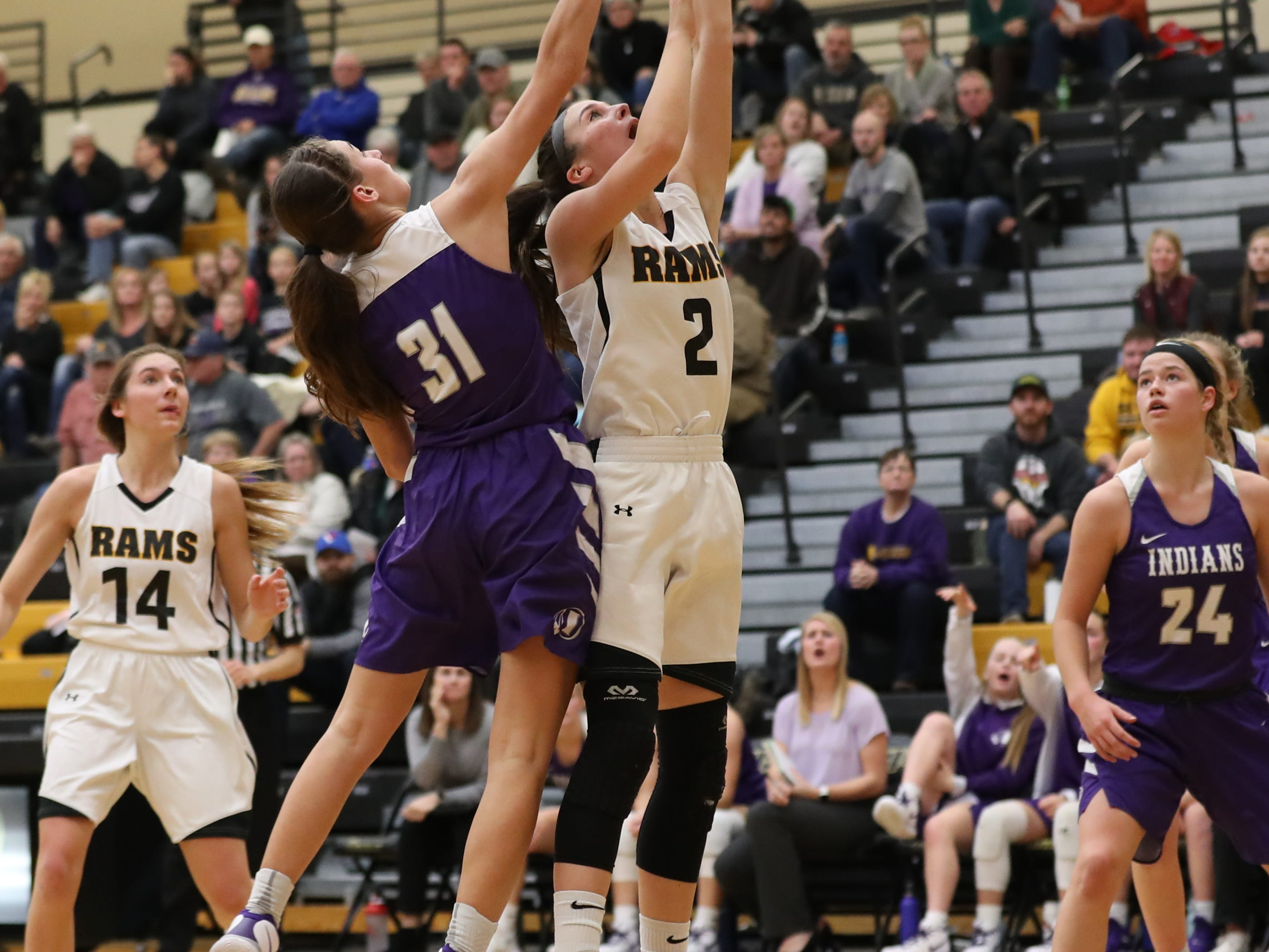 Nov 20, 2018; Pleasant Hill, IA, USA; Southeast Polk Rams Liza Sutten (2) shoots in front of Indianola's Jadyn Forbes during their game at Southeast Polk Gymnasium.