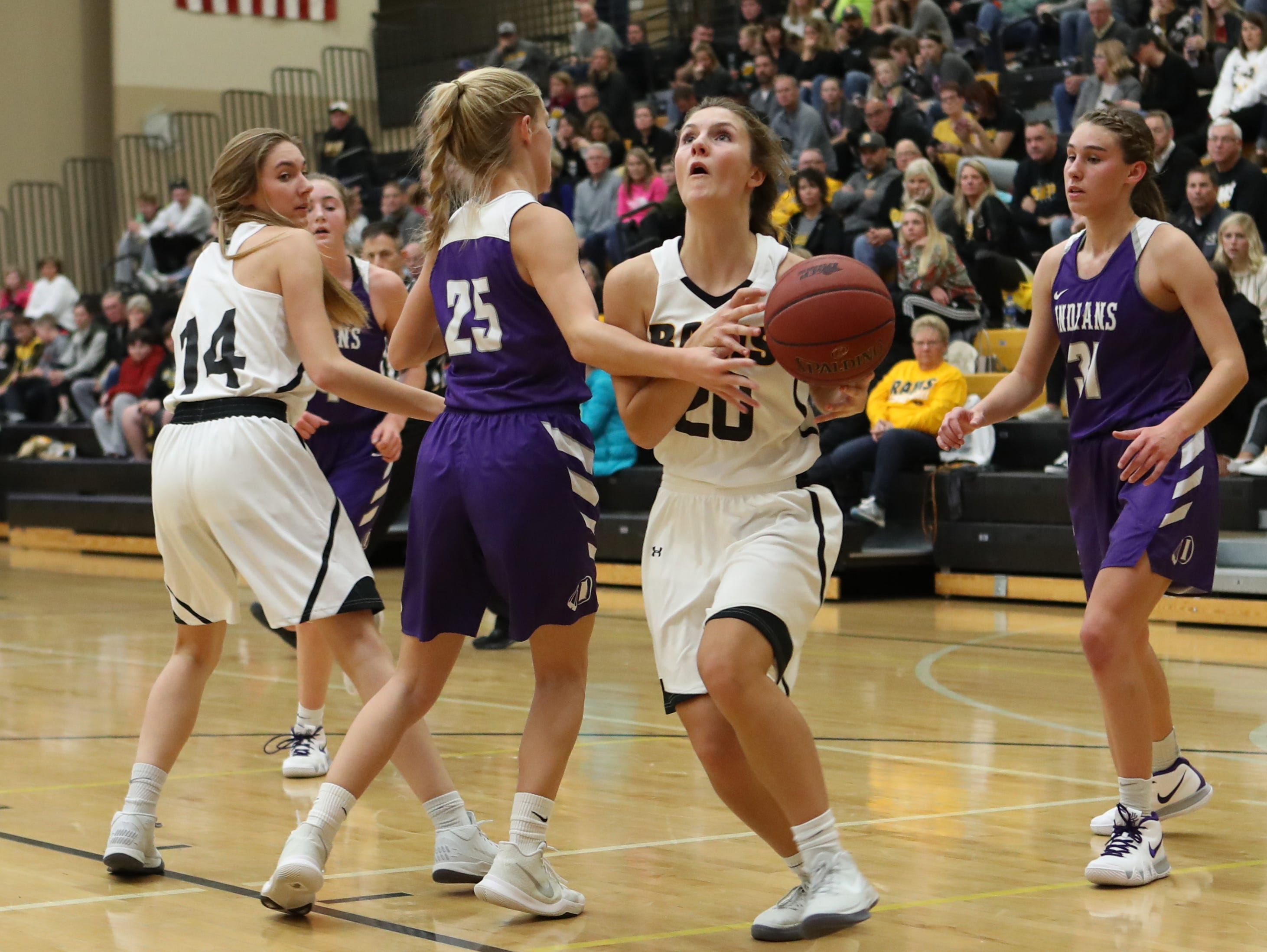 Nov 20, 2018; Pleasant Hill, IA, USA; Southeast Polk Rams Sami Albertson (20) scores an easy basket against the Indianola Indians at Southeast Polk Gymnasium.