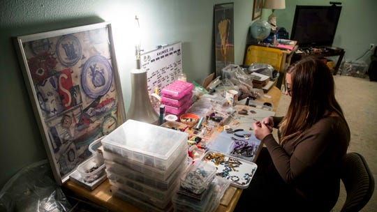 Nicole Rutherford, who is a mom and a crafter, in her basement making jewelry  Tuesday, Nov. 20, 2018, in West Des Moines, Iowa. The hours and home life appealed to Rutherford in the making/crafting industry, which is dominated by women.
