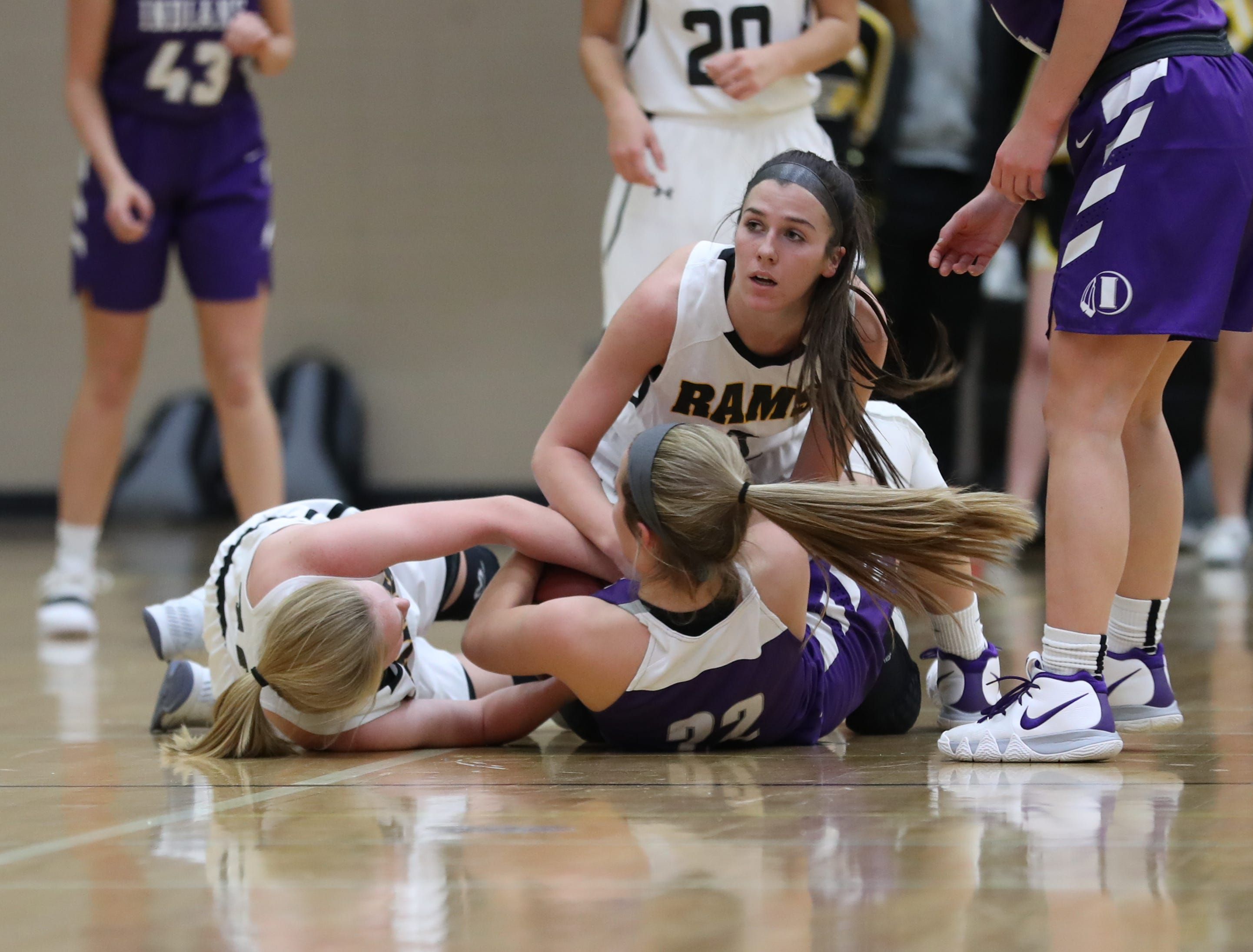 Nov 20, 2018; Pleasant Hill, IA, USA; Southeast Polk Rams Liza Sutten (2) and Southeast Polk Rams Grace Larkins (10) battle Indianola's Kendall Clatt for a lose ball during their game at Southeast Polk Gymnasium.