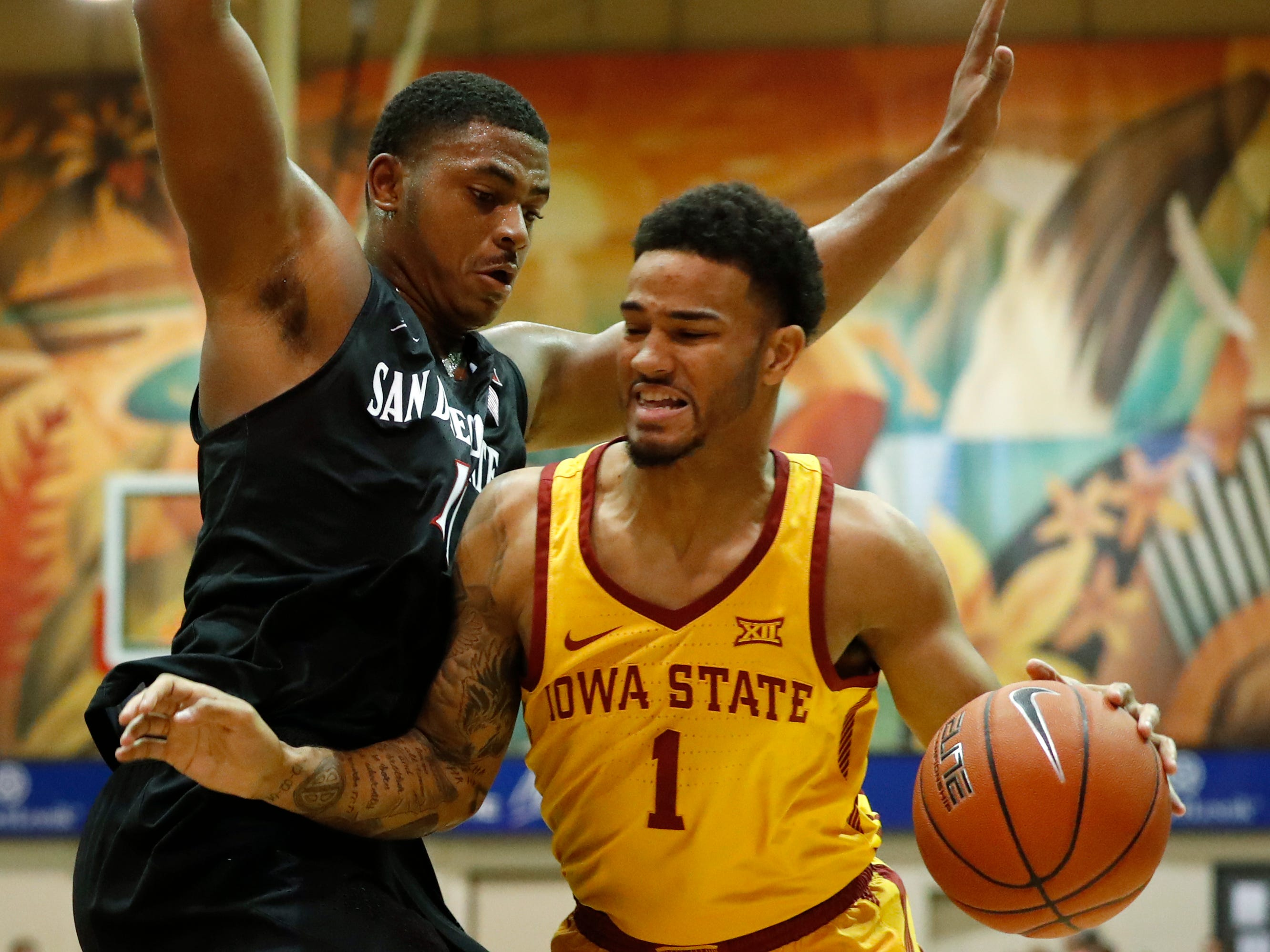 Iowa State guard Nick Weiler-Babb (1) runs into San Diego State forward Matt Mitchell (11) during the first half of a NCAA college basketball game at the Maui Invitational, Wednesday, Nov. 21, 2018, in Lahaina, Hawaii. (AP Photo/Marco Garcia)