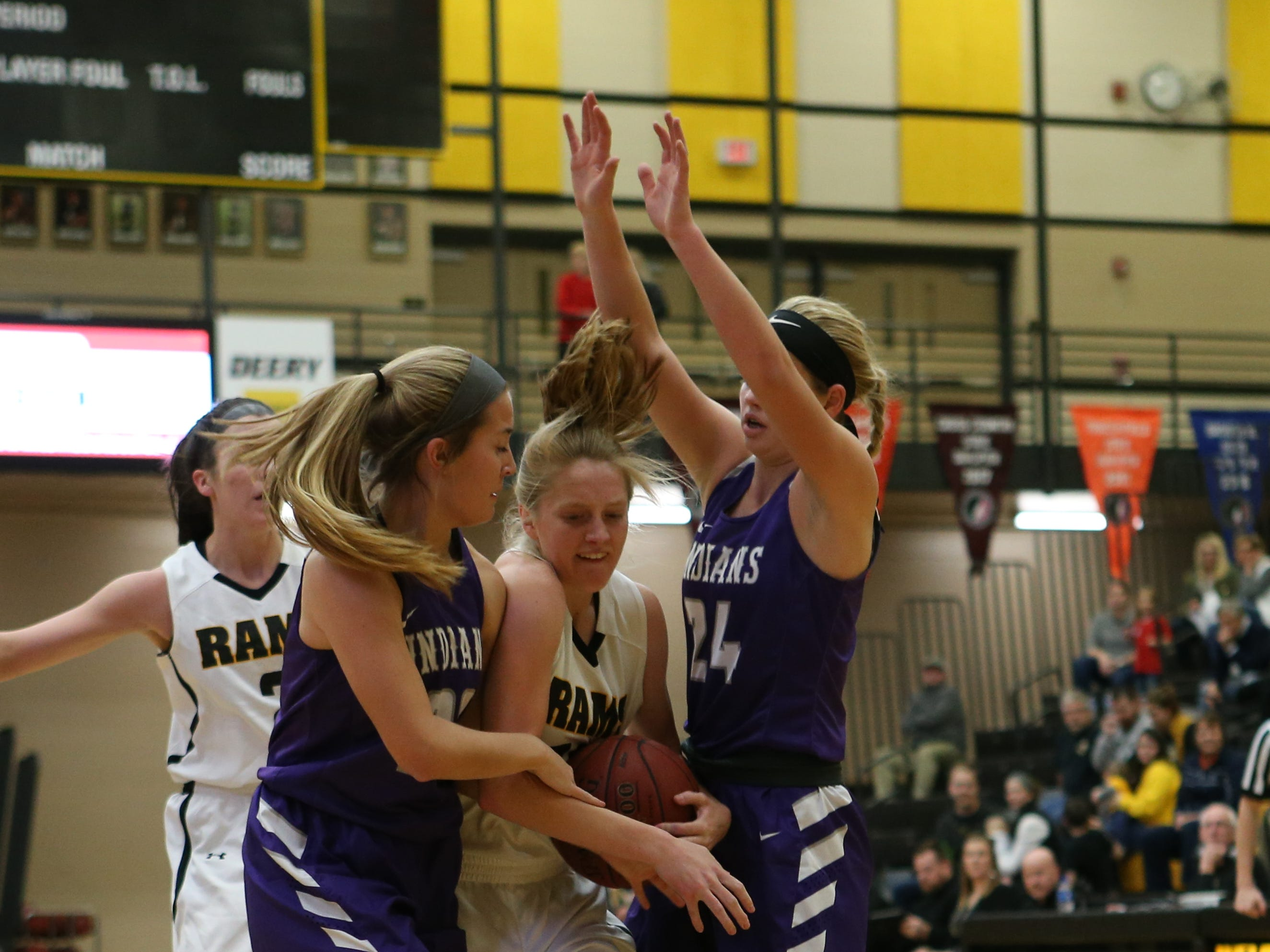 Nov 20, 2018; Pleasant Hill, IA, USA;Southeast Polk Rams Grace Larkins (10) is fouled while driving the lane during their game with the Indianola Indians at Southeast Polk Gymnasium.
