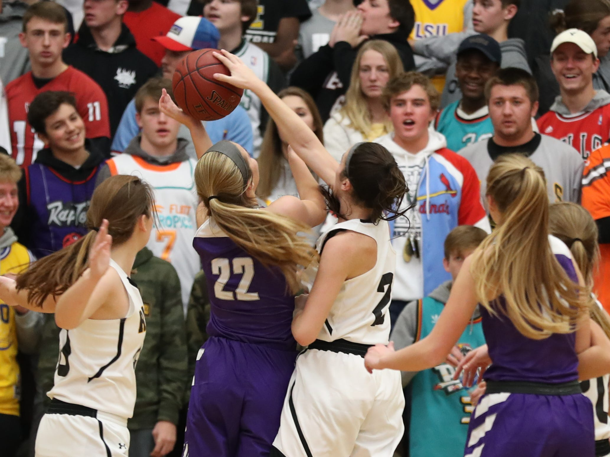 Nov 20, 2018; Pleasant Hill, IA, USA; Southeast Polk Rams Liza Sutten (2) blocks Indianola's Kendall Clatt during their game at Southeast Polk Gymnasium.