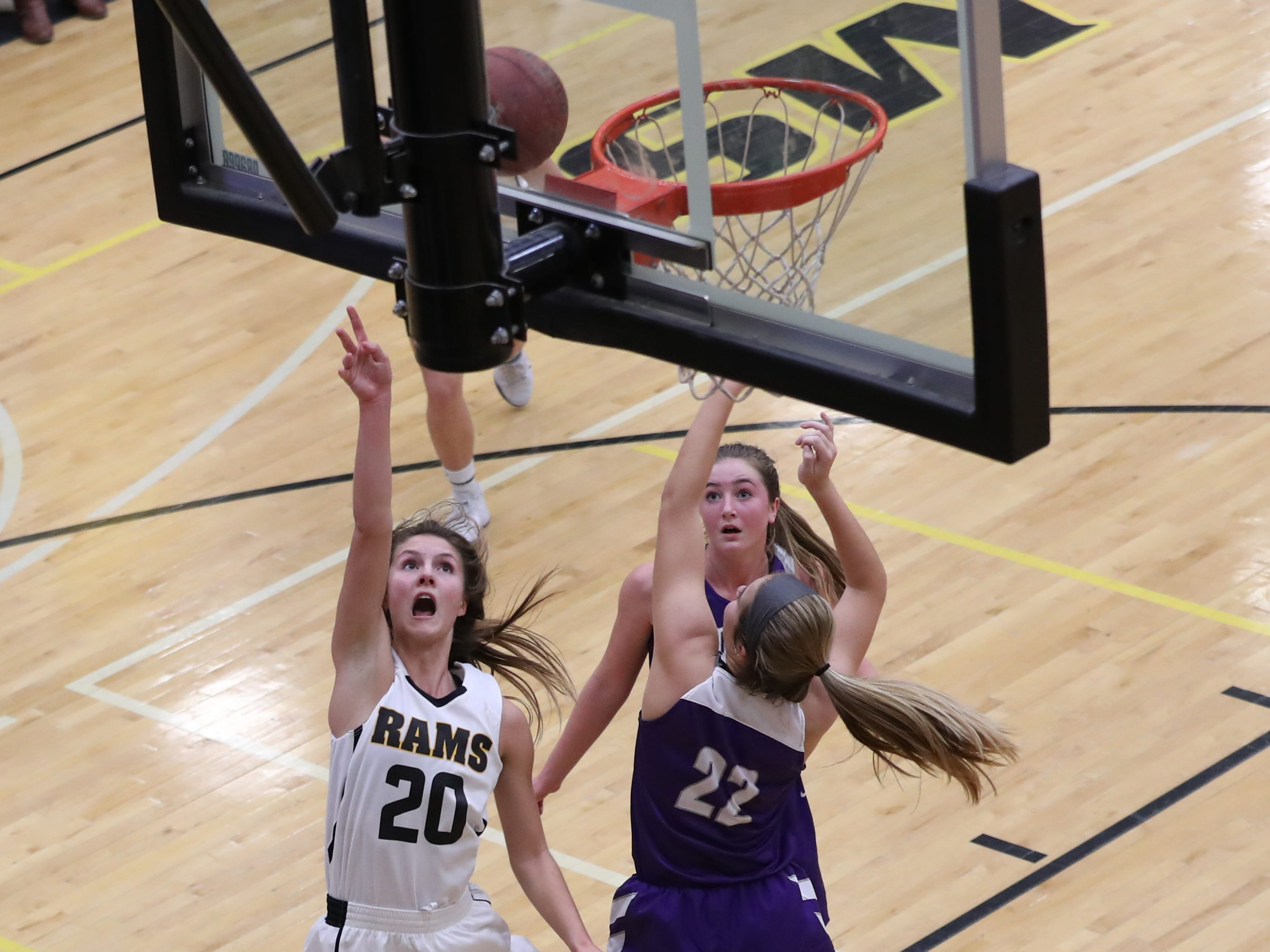 Nov 20, 2018; Pleasant Hill, IA, USA; Southeast Polk Rams Sami Albertson (20) shoots the ball against the Indianola Indians at Southeast Polk Gymnasium.