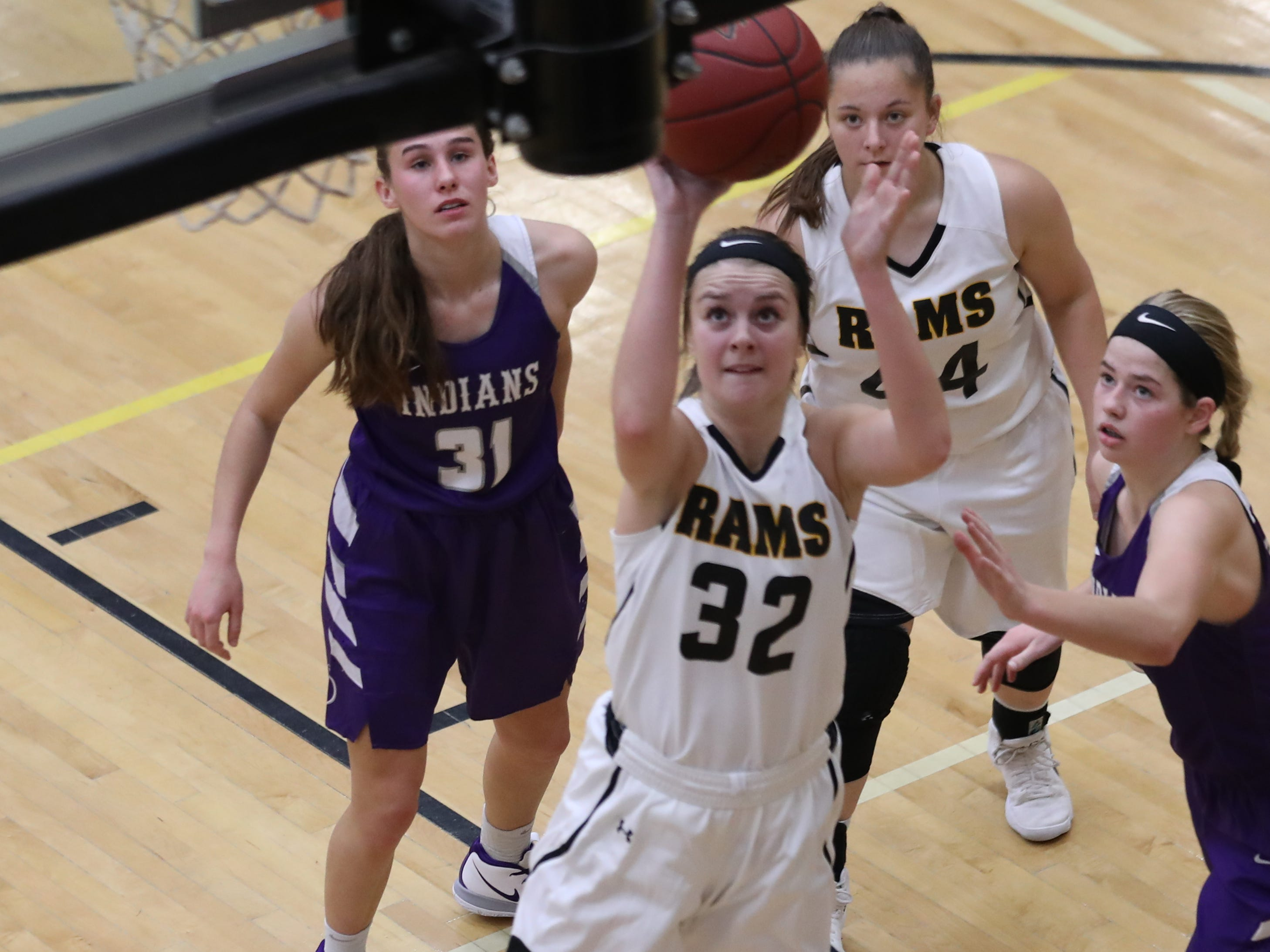 Nov 20, 2018; Pleasant Hill, IA, USA;Southeast Polk Rams Maggie McGraw (32) scores a basket against the Indianola Indians at Southeast Polk Gymnasium.