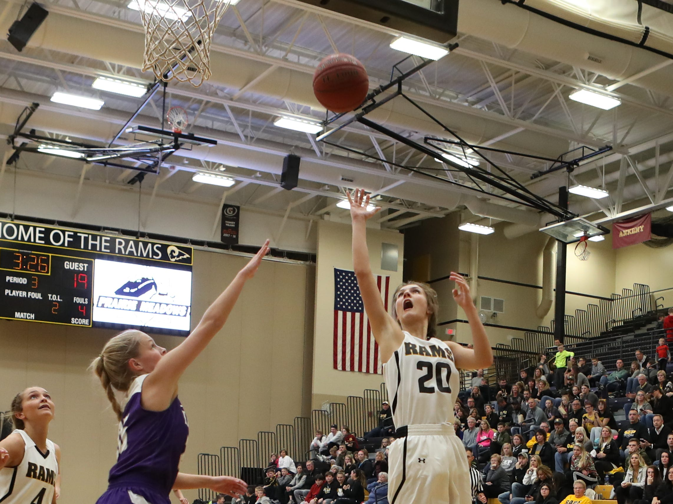 Nov 20, 2018; Pleasant Hill, IA, USA;  Southeast Polk Rams Sami Albertson (20) scores a basket against the Indianola Indians at Southeast Polk Gymnasium.