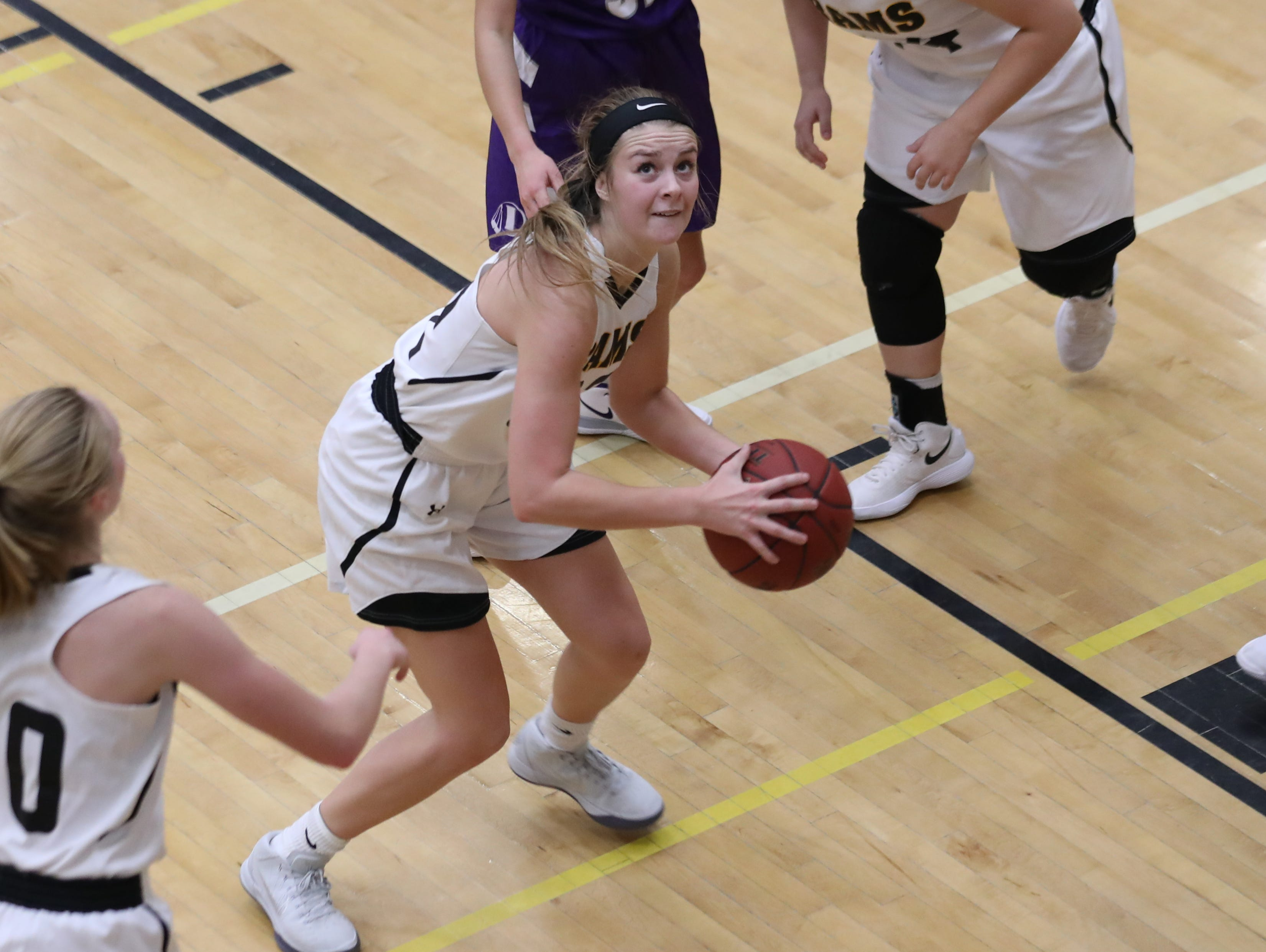 Nov 20, 2018; Pleasant Hill, IA, USA; Southeast Polk Rams Maggie McGraw (32) looks to shoot against the Indianola Indians at Southeast Polk Gymnasium.