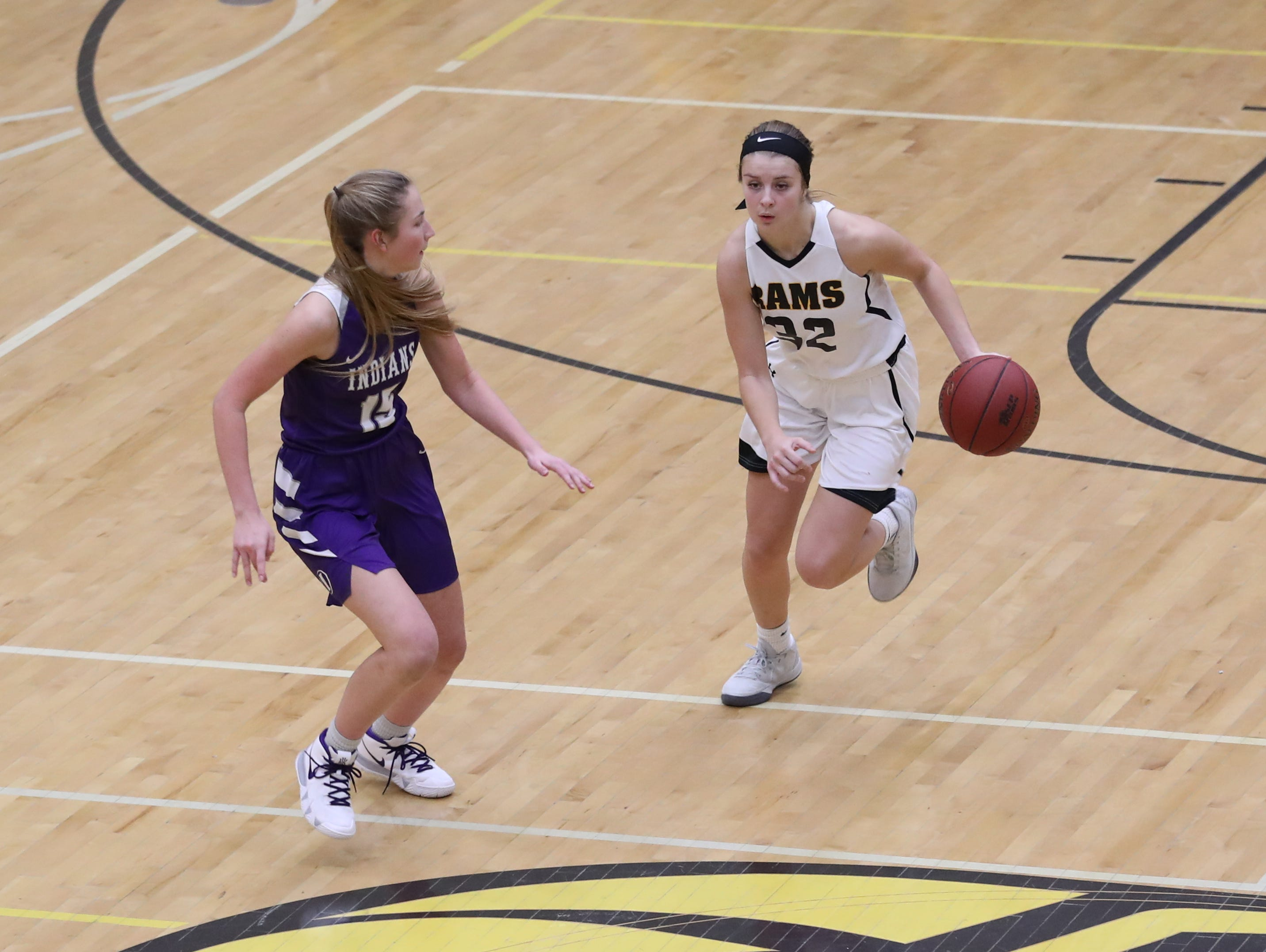 Nov 20, 2018; Pleasant Hill, IA, USA; Southeast Polk Rams Maggie McGraw (32) brings the ball up the court against the Indianola Indians at Southeast Polk Gymnasium.