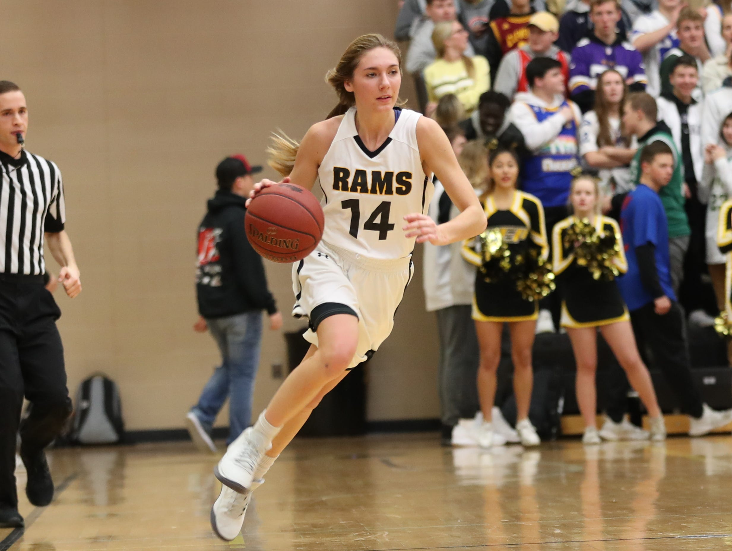 Nov 20, 2018; Pleasant Hill, IA, USA; Southeast Polk Rams Jessica Stuart (14) brings the ball up the floor during their game with the Indianola Indians at Southeast Polk Gymnasium.
