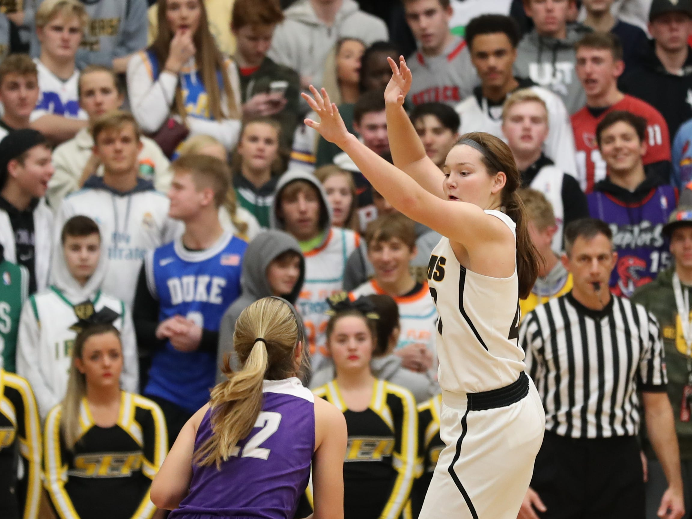 Nov 20, 2018; Pleasant Hill, IA, USA; Indianola's Kendall Clatt is defended by Southeast Polk Rams Kadence Williams (44) during their game at Southeast Polk Gymnasium.