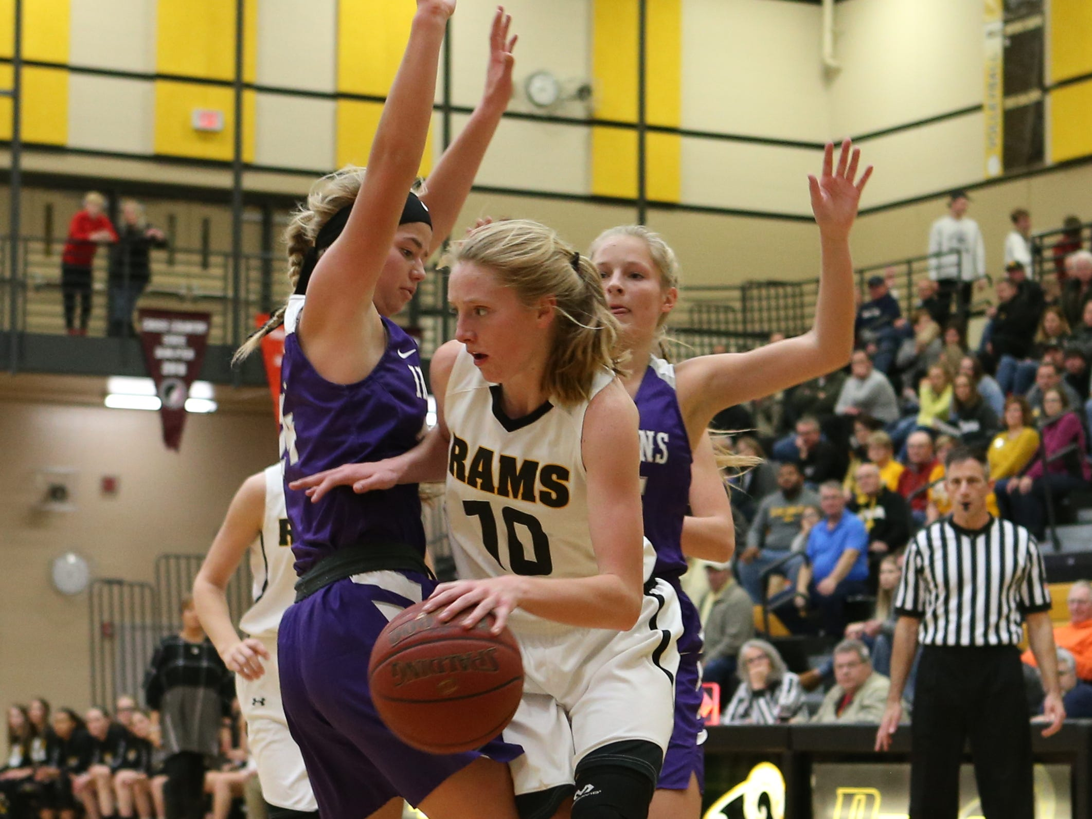 Nov 20, 2018; Pleasant Hill, IA, USA; Southeast Polk Rams Grace Larkins (10) drives baseline during their game with the Indianola Indians at Southeast Polk Gymnasium.