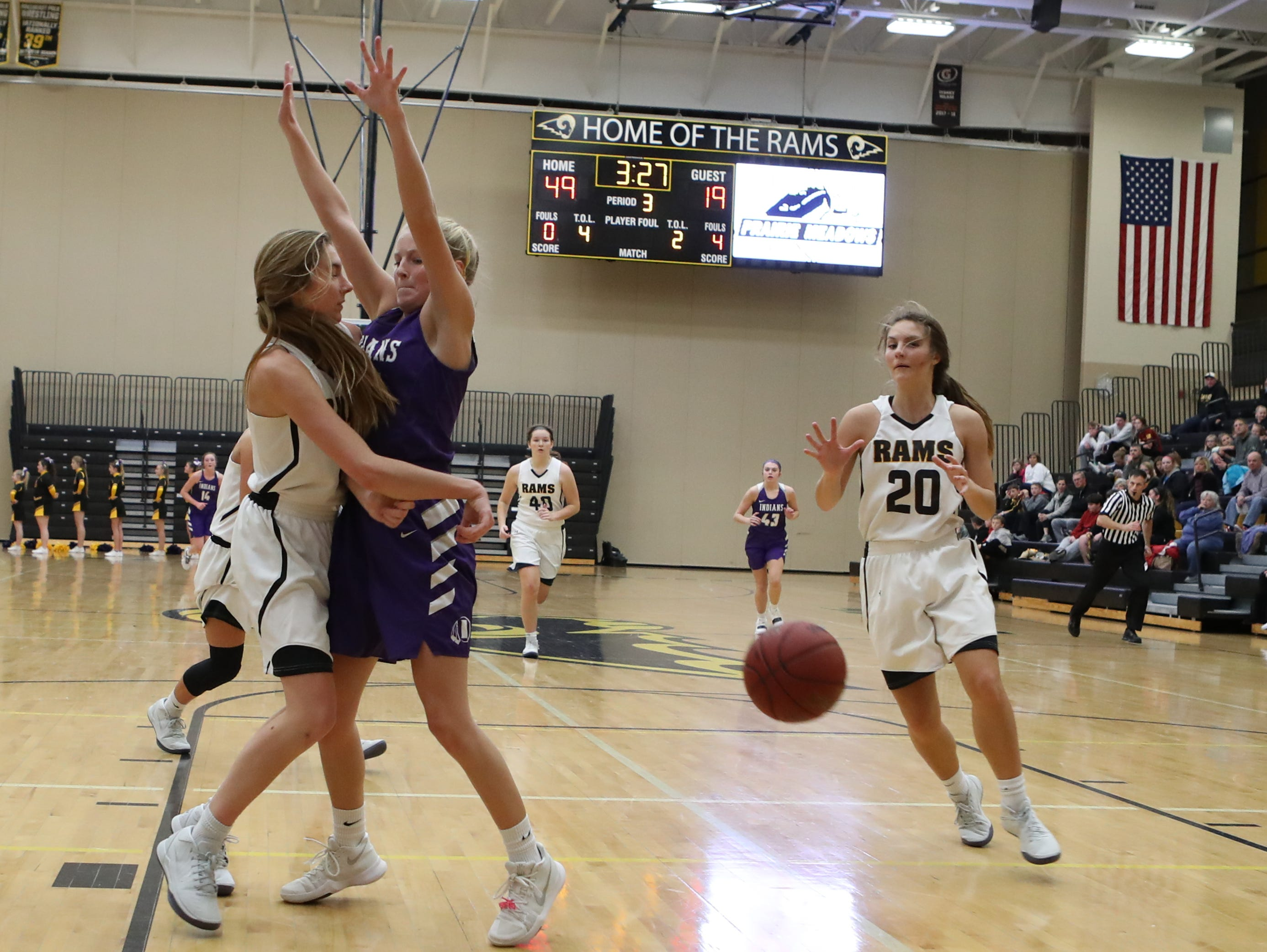 Nov 20, 2018; Pleasant Hill, IA, USA; Southeast Polk Rams Jessica Stuart (14) passes to Southeast Polk Rams Sami Albertson (20) for a easy bucket against the Indianola Indians at Southeast Polk Gymnasium.