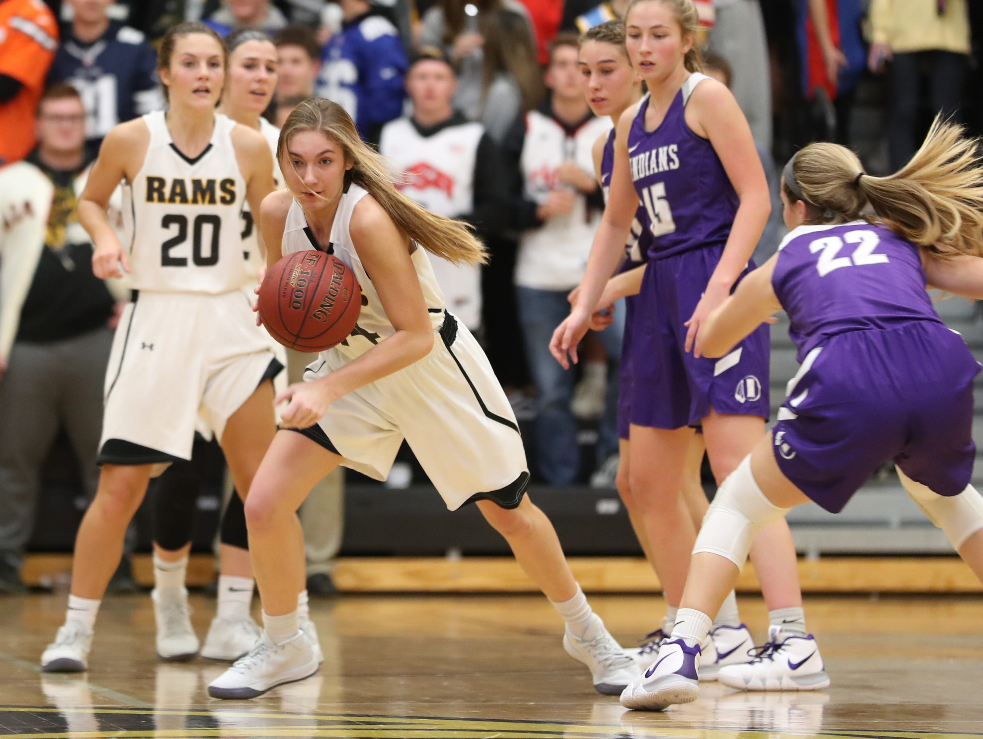 Nov 20, 2018; Pleasant Hill, IA, USA; Southeast Polk Rams Jessica Stuart (14) drives the lane during their game with the Indianola Indians at Southeast Polk Gymnasium.