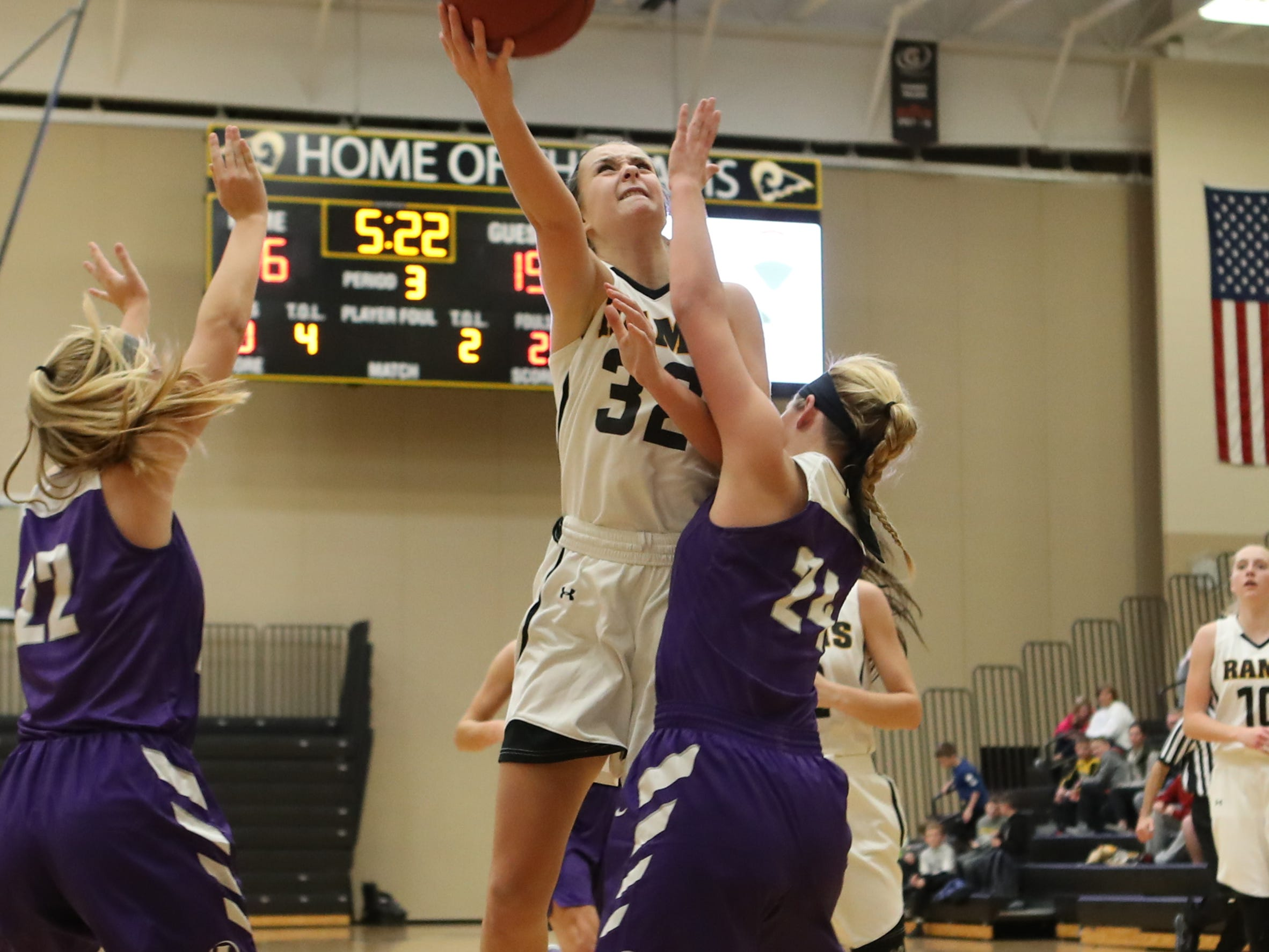 Nov 20, 2018; Pleasant Hill, IA, USA; Southeast Polk Rams Maggie McGraw (32) scores a basket against the Indianola Indians at Southeast Polk Gymnasium.