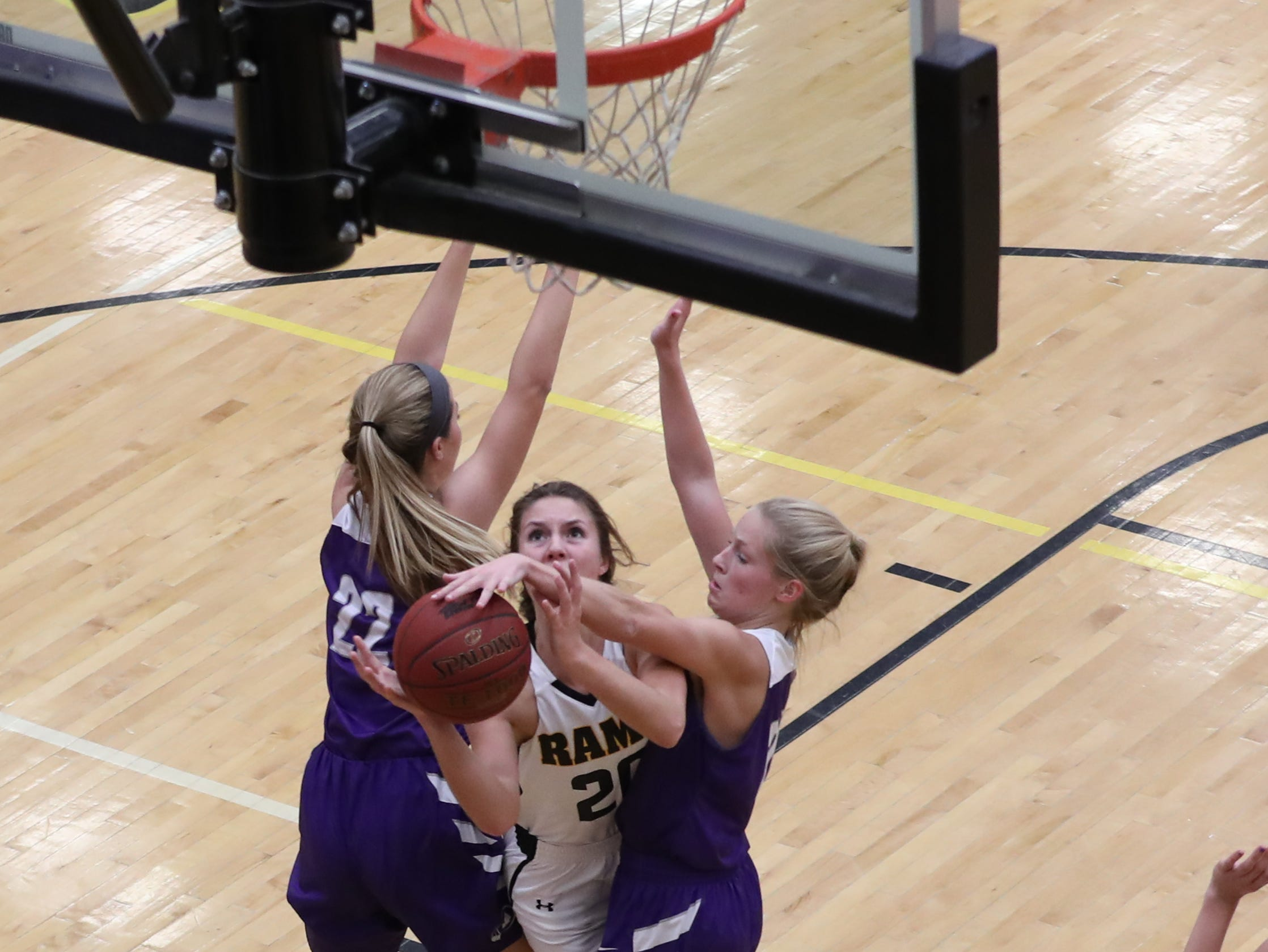 Nov 20, 2018; Pleasant Hill, IA, USA; Indianola Indians Jessie Woodyard blocks the shot of Southeast Polk Rams Sami Albertson (20) at Southeast Polk Gymnasium.