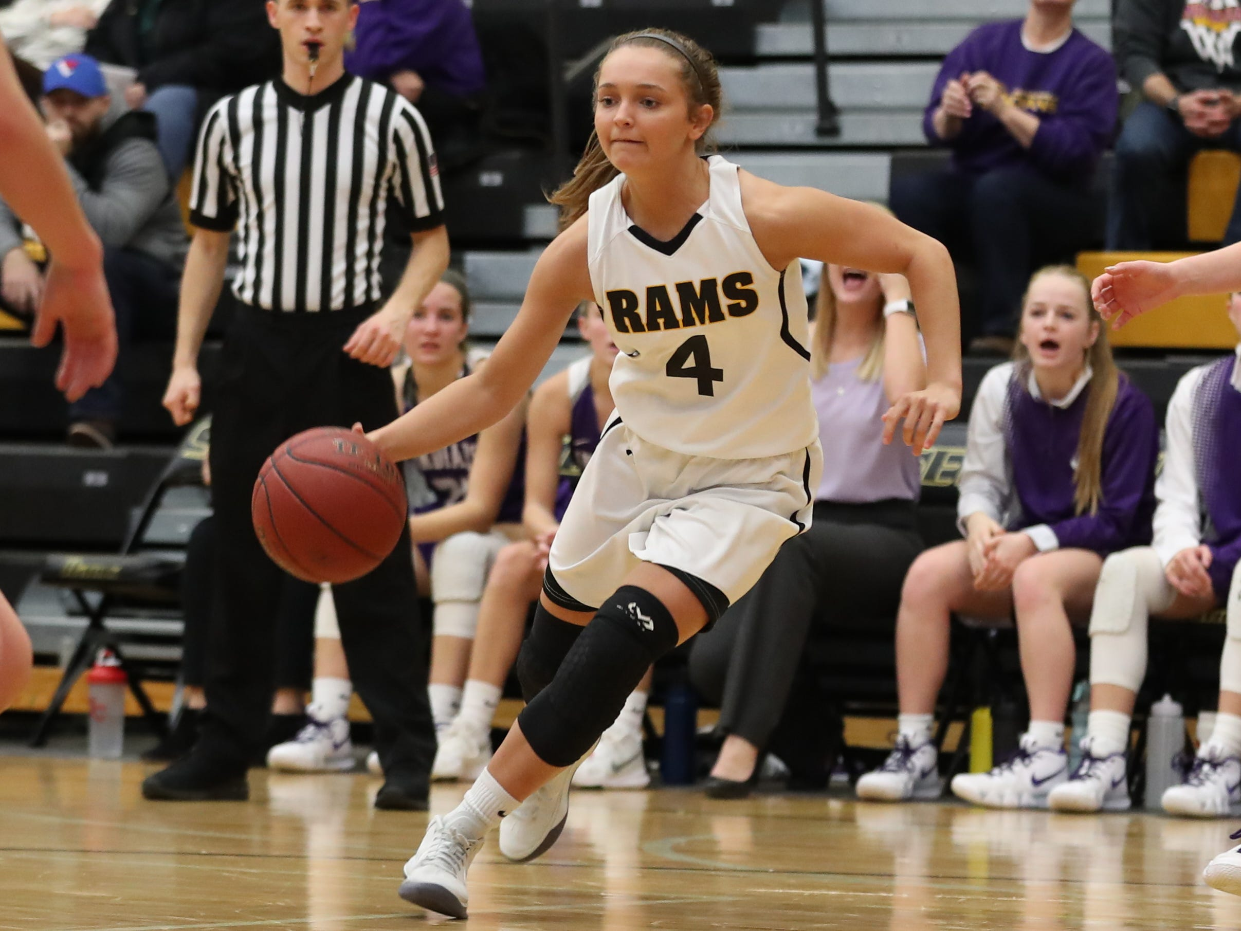 Nov 20, 2018; Pleasant Hill, IA, USA; Southeast Polk Rams Jaycie Elliott (4) drives to the basket during their game with the Indianola Indians at Southeast Polk Gymnasium.