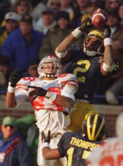 Michigan's Charles Woodson comes up with an interception against Ohio State's Terry Glenn.